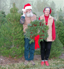 Chris and Elizabeth with a Christmas wreath